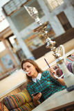 Beautiful young woman smokes a hookah in a cafe Royalty Free Stock Photography