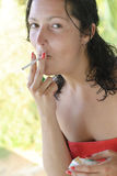 Beautiful young woman smoking cigarette Royalty Free Stock Images