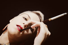 Beautiful young woman smoking cigarette Stock Photography