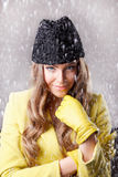 Beautiful young woman in the snow Stock Photography