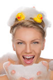 Beautiful young woman with soapy foam and ducks Royalty Free Stock Photography