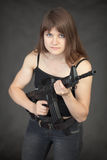 Beautiful young woman - soldier with a rifle Stock Photos