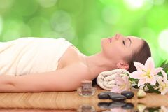 Young woman in a spa. Beautiful young woman in a spa royalty free stock photo