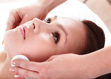 Beautiful young woman in spa. Facial Royalty Free Stock Image