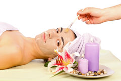 Applying Facial Mask Stock Photography