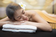 Beautiful young woman in spa salon, Body care. Spa body massage woman hands treatment. Woman having massage in the spa salon royalty free stock image