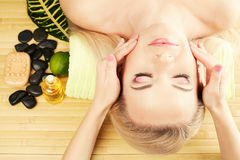 Beautiful young woman at a spa salon Stock Photos