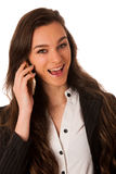 Beautiful young woman speaking on a cell phone isolated over whi Royalty Free Stock Photos