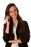 Beautiful young woman speaking on a cell phone Royalty Free Stock Images