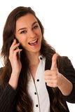 Beautiful young woman speaking on a cell phone Stock Images