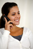 Beautiful young woman speaking on cellphone Royalty Free Stock Photos
