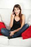 Beautiful young woman speaking by mobile phone Stock Photography