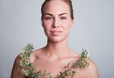 Beautiful young woman with spiraea Stock Images