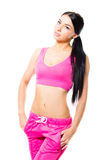 Beautiful young woman in sport wear studio shot on white background Royalty Free Stock Photography
