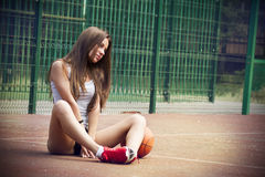 Beautiful young woman on the sports ground Stock Photography