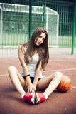 Beautiful young woman on the sports ground Royalty Free Stock Images