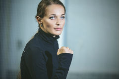 Beautiful young woman in sportswear is engaged in the sports sta stock photo