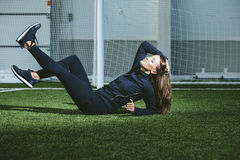 Beautiful young woman in sportswear is engaged in the sports sta royalty free stock image