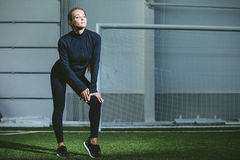 Beautiful young woman in sportswear is engaged in the sports sta stock image