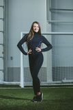 Beautiful young woman in sportswear is engaged in the sports sta royalty free stock photo