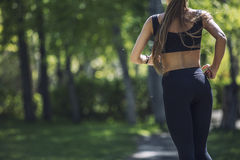 Beautiful young woman in sportswear Jogging in the Park with Stock Image