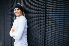 Beautiful young woman in sportswear looking happy Royalty Free Stock Photography