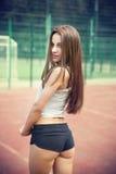Beautiful young woman in sportswear Stock Photography