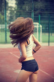 Beautiful young woman in sportswear Stock Images