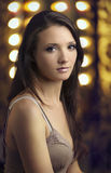 Beautiful Young Woman with Spotlights Stock Images