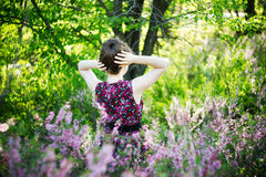 Beautiful young woman with spring flowers Royalty Free Stock Images