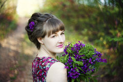 Beautiful young woman with spring flowers Stock Images