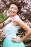 Beautiful young woman at spring garden Stock Photography