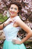 Beautiful young woman at spring garden Stock Photo
