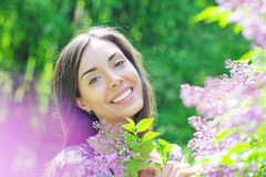 Beautiful young woman in spring garden Stock Photo