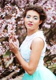 Beautiful young woman at spring garden Royalty Free Stock Images