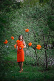 Beautiful young woman in a spring park with the decor pompons Royalty Free Stock Image