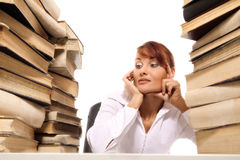 Beautiful young woman with stack of books. On white background stock photography