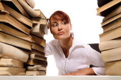 Beautiful young woman with stack of books. On white background royalty free stock photography