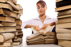 Beautiful young woman with stack of books. On white background royalty free stock images