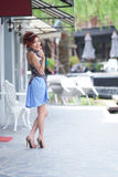 Beautiful young woman stand alone at the outdoor cafe Royalty Free Stock Photography