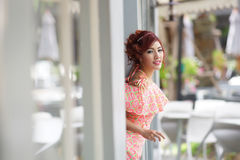 Beautiful young woman stand alone at the outdoor mall Stock Photo