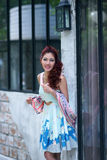 Beautiful young woman stand alone at the outdoor mall. Model is Thai Ethnicity Stock Image
