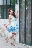 Beautiful young woman stand alone at the outdoor mall. Model is Thai Ethnicity Royalty Free Stock Image