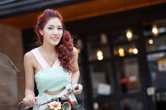 Beautiful young woman stand alone at the outdoor mall. Model is Thai Ethnicity Royalty Free Stock Photos