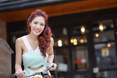 Beautiful young woman stand alone at the outdoor mall Stock Images