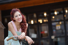 Beautiful young woman stand alone at the outdoor mall Royalty Free Stock Photo