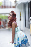 Beautiful young woman stand alone at the outdoor mall Stock Photography