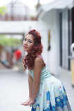 Beautiful young woman stand alone at the outdoor mall Stock Photos