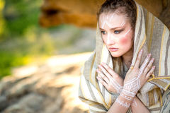 Beautiful young woman standing in ancient dress stock image