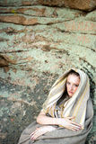 Beautiful young woman standing in ancient dress royalty free stock photography